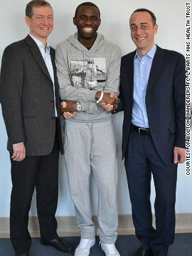 Fabrice Muamba shaking hands with Dr Andrew Deaner (left) and Dr Sam Mohiddin (right) from Barts Health NHS Trust. The 24-year-old Bolton Wanderers midfielder suffered a cardiac arrest during a match against Tottenham Hotspur on March 17.