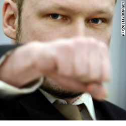 Rightwing extremist Anders Behring Breivik, who killed 77 people in twin attacks in Norway last year, makes a farright salute as he enters the Oslo district courtroom at the opening of his trial on April 16, 2012.