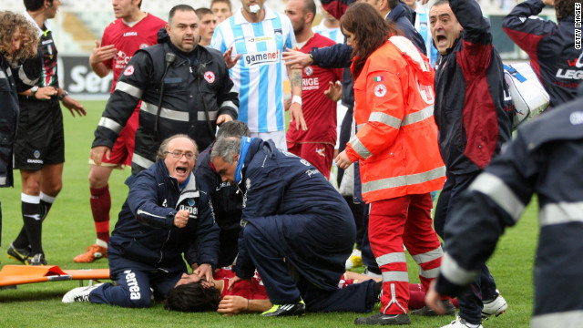 Emergency teams rush onto the pitch to treat Morosoni after his shock collapse. A defibrillator was used before an ambulance took the 25-year-old to Pescara's Santo Spirito hospital. Doctors tried unsuccessfully to revive him for 30 minutes.