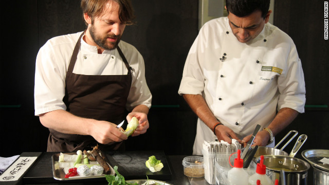 Back in the kitchen, Redzip shows Kapoor how to prepare a simple dish in the Noma style, using only local ingredients.