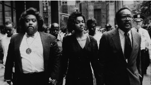 Tawana Brawley holds hands with Sharpton and her attorney outside the New York Supreme Court in 1990.