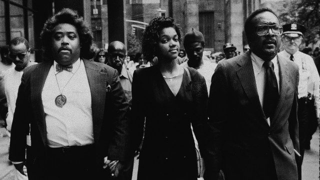 Tawana Brawley holds hands with Al Sharpton, left, in 1990.