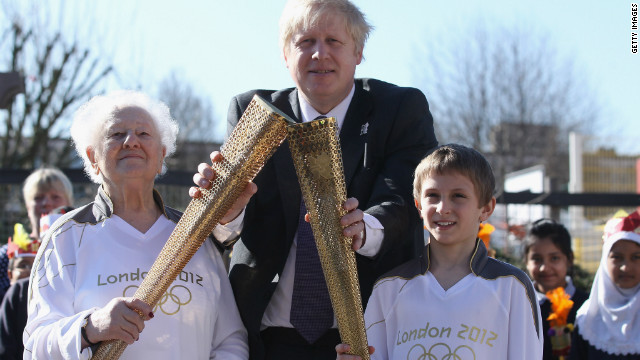 London 2012 Olympic Torchbearers Dinah Gould and Dominic John MacGowan pose with Mayor of London Boris Johnson on March 19, 2012.