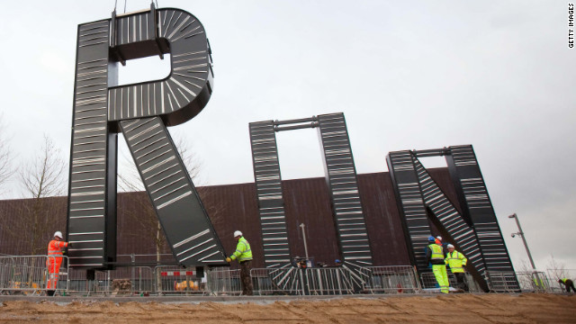 "Workers carry out the installation of artist Monica Bonvicini's ""RUN'""sculpture in the plaza of the London 2012 Handball Arena at the Olympic Park on January 12, 2012."