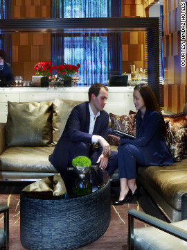 The lobby lounge at New York's Andaz Wall Street, where guests check in on a tablet computer over a drink.