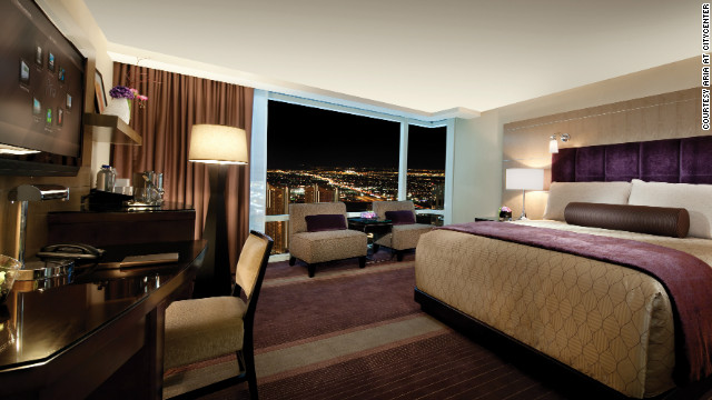 The interior of a deluxe king room at the Las Vegas Aria at CityCenter. The room has intelligent lighting and curtains that automatically open on a guest's arrival to showcase a view of the city's lights.