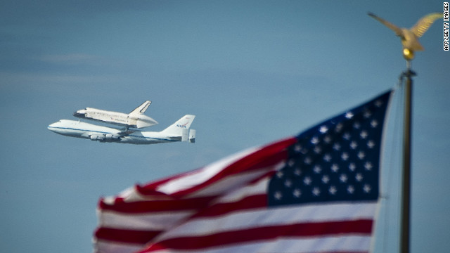Discovery flies over the National Mall on Tuesday as it arrives from Kennedy Space Center in Florida. The space shuttle Enterprise, which has been on display at the Smithsonian's Steven F. Udvar-Hazy Center since 1985, will be moved to the Intrepid Sea, Air &amp; Space Museum in New York.