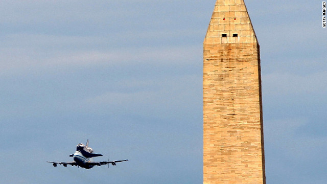 Photos: Discovery flies into retirement