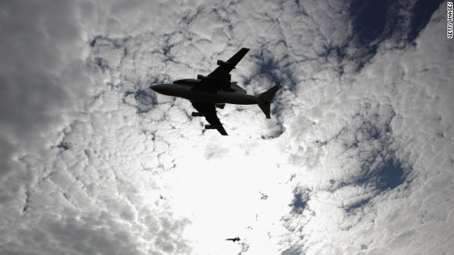 Discovery and its 747 jumbo jet carrier pass over the Smithsonian National Air and Space Museum annex in Chantilly, Virginia, on Tuesday. The shuttle will be removed from the modified jet and star as the guest of honor at a four-day celebration punctuated by a ceremony Thursday formally welcoming Discovery to the Smithsonian collection.
