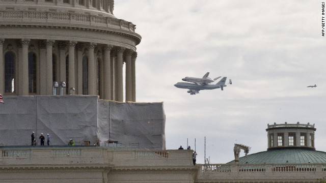Shuttle Discovery flies past the U.S. Capitol in Washington on Tuesday.