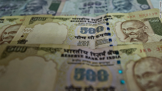 Indian Currency notes are pictured in New Delhi on December 7, 2011