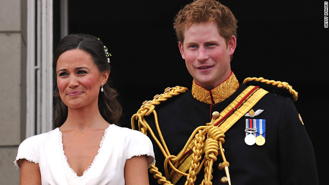 Best man Prince Harry and Maid of Honour Pippa Middleton appear on the balcony at Buckingham Palace after the royal wedding of Prince William to Catherine Middleton on April 29, 2011.