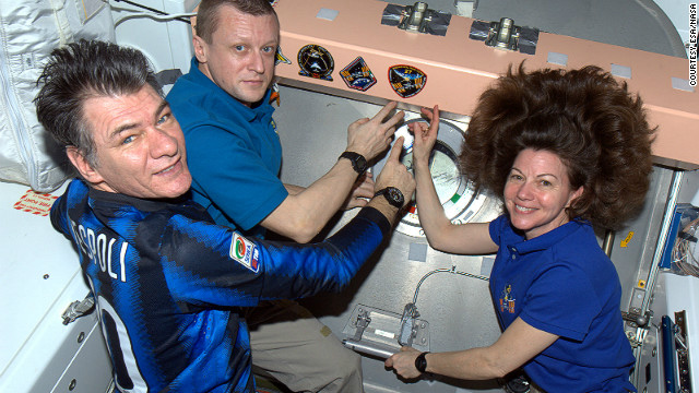 The 55-year-old Italian (seen here on the left) with fellow crew members, Russian cosmonaut Dmitry Kondratyev and NASA flight engineer, Cady Coleman.