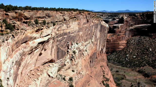 Visitors to Canyon De Chelly in Arizona can get a view of Massacre Cave at the Massacre Cave Overlook on the north rim drive of the park.