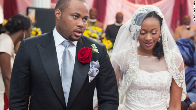 A new bride, wearing Kosibah, and her husband at a Nigerian wedding. Nigerian weddings are becoming increasingly extravagant affairs.