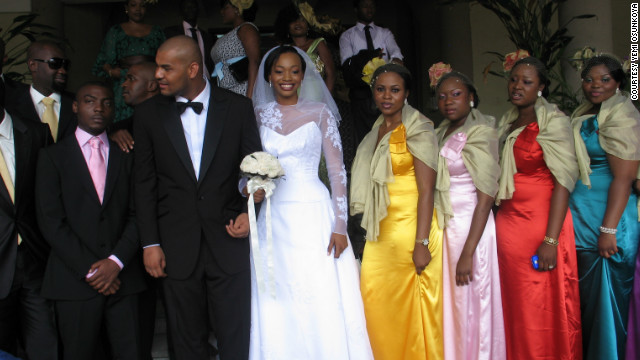 A bride wearing a Kosibah wedding gown, and the bridal party at a Nigerian wedding. Nigerian weddings feature two ceremonies: a traditional ceremony and a &quot;white wedding.&quot;