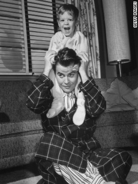 American TV personality Dick Clark plays with his son, circa 1955. Clark died Wednesday at age 82.