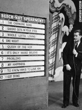 "Clark announces the week's top 10 popular songs during an episode of the TV show, ""American Bandstand,"" circa 1958."