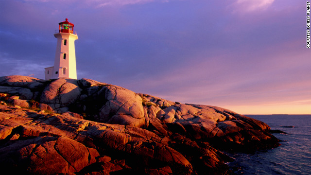 The highlight at Peggy's Cove is a near-perfect lighthouse perched on a billow of bare granite boulders with waves below. 