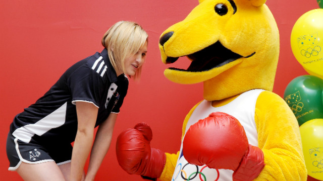 Melissa Wu, a diving silver medallist four years ago, poses with Australia's Boxing Kangaroo Olympic mascot as the 100-day landmark is celebrated in Sydney.