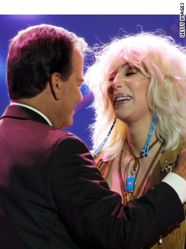 "Clark and Cher hug during the taping of the 50th anniversary speical of ""American Bandstand."""