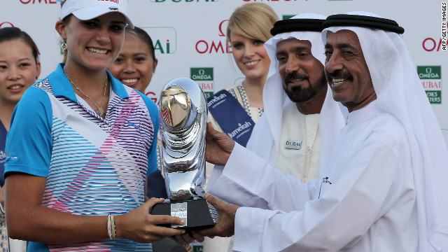 Thompson is also the youngest player to win on the European Ladies' Tour. Here she receives her trophy at the Dubai Ladies Masters on December 17, 2011.