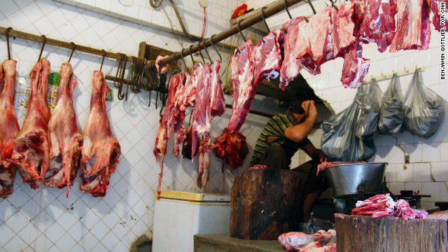 Beef hangs from meat hooks in the butcher's quarter of Nizamuddin, Delhi, on March 12. This year, India will displace the United States as the world's third largest beef exporter.