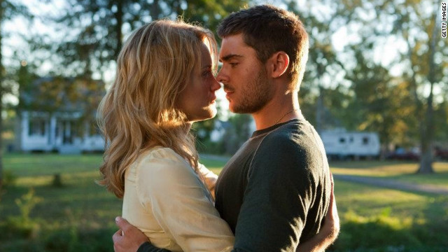 Taylor Schilling and Zac Efron star in