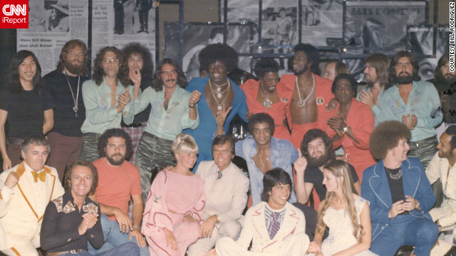 "Drummer Bill Rodriguez was among those who posed for this large group photo with Clark for his Las Vegas show in the 1970s. Rodriguez admitted to a mistake in one of the performances: ""I was so nervous I launched into the 'Bandstand' theme all by myself before Dick's monologue, leaving Dick alone on the stage with a mic while I played by myself before realizing I'd just massively blown it. Dick just told the audience, 'Ah, the enthusiasm of youth,' and made it seem as if it was part of the show. "" <br/><br/>"