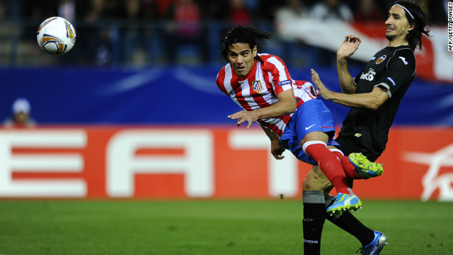 Colombian striker Falcao scores Atletico's first goal in their 4-2 victory over Valencia in the Europa League
