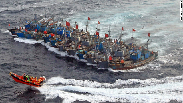 Chinese fishing boats encounter a South Korean coast guard boat while in the Yellow Sea in December 2010.