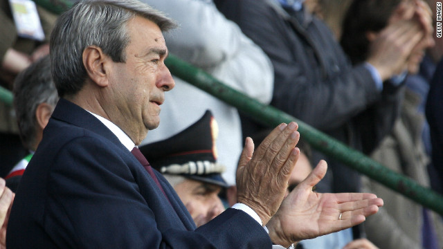 Livorno's president Aldo Spinelli struggles to hold back tears as he salutes the hearse carrying Morosini's coffin at a memorial ceremony.<br/><br/>