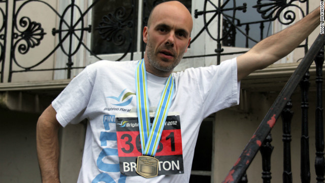 Peter Wilkinson proudly wears the medal he received for completing the 2012 Brighton Marathon.