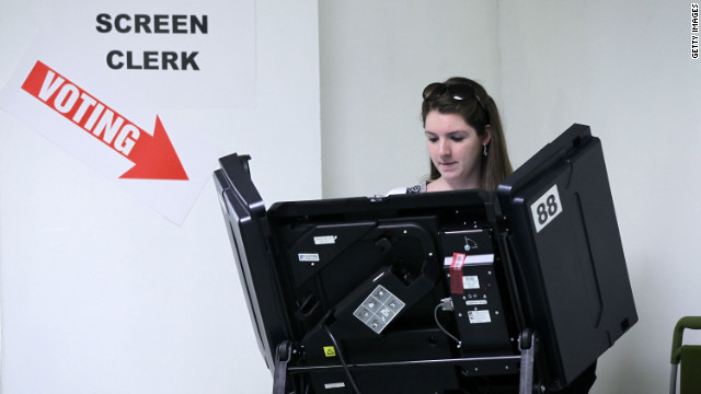A citizen casts her vote at a polling station April 3 in Washington. 