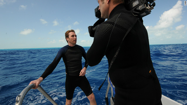 Philippe Cousteau prepares to go diving to witness the extent of the lionfish problem in the waters off Florida.