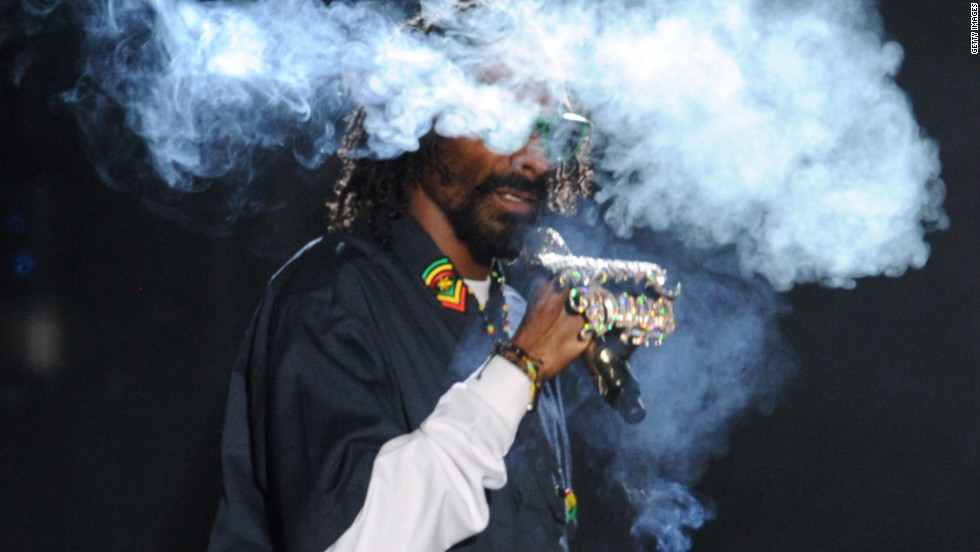"Snoop is such a fan, he's created <a href='http://www.youtube.com/watch?v=HkfC2dfNHGM&feature=player_embedded' target='_blank'>""Rolling Words: A Smokable Songbook,""</a> a book of lyrics ... printed on rolling papers. You can even light a match on the book's spine."