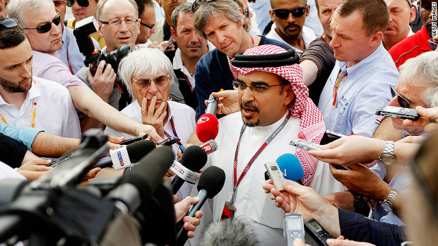 Bahrain's Crown Prince Salman bin Hamad Al Khalifa (R) and F1 chief Bernie Ecclestone face the press Friday
