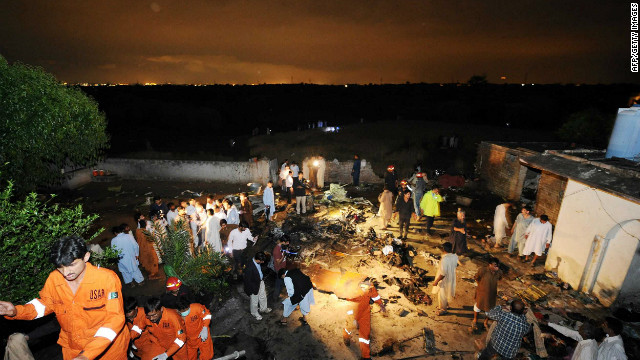 Pakistani rescue workers and local residents search the site of a plane crash in Rawalpindi on Friday, April 20. There is &quot;no chance&quot; of any survivors after a plane carrying up to 130 people crashed while trying to land in bad weather near Islamabad, police said.