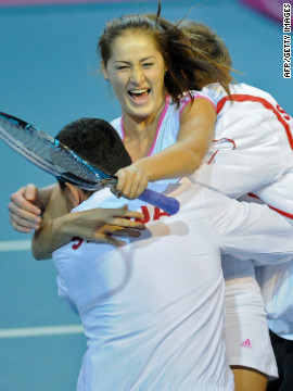 Serbia's Bojana Jovanovski celebrates her victory with coach Dejan Vranes after she helped to beat Belgium in Charleroi.&lt;br/&gt;&lt;br/&gt; 
