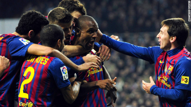 Eric Abidal is congratulated after scoring in Barcelona's 2-1 Copa Del Rey win over Real Madrid in January. It was only his second goal for the Catalans. The France international has since had a liver transplant.