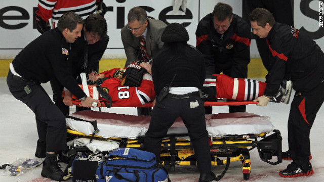 Marian Hossa of the Chicago Blackhawks is placed on a stretcher after being dropped by the Phoenix Coyotes' Raffi Torres.
