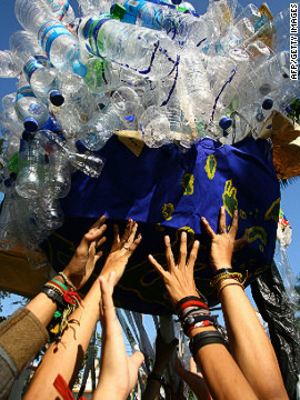 Environmental activists in Indonesia hold up plastic bottles during the Earth Day event.