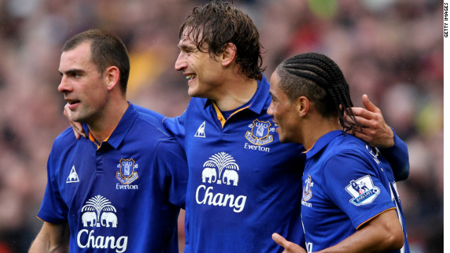 Everton's players celebrate as they battled to a 4-4 draw at Old Trafford against Manchester United.