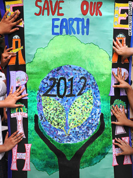 Children in Kolkata, India hold a poster promoting this year's Earth Day.
