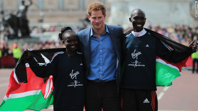Prince Harry is flanked by the London Marathon winners Wilson Kipsang and Mary Keitany.