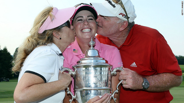 Creamer celebrates her 2010 U.S. Open win with her parents, Paul and Karen. Her dad was a Navy pilot for 22 years and will help in her new project to support the wives and families of soliders.