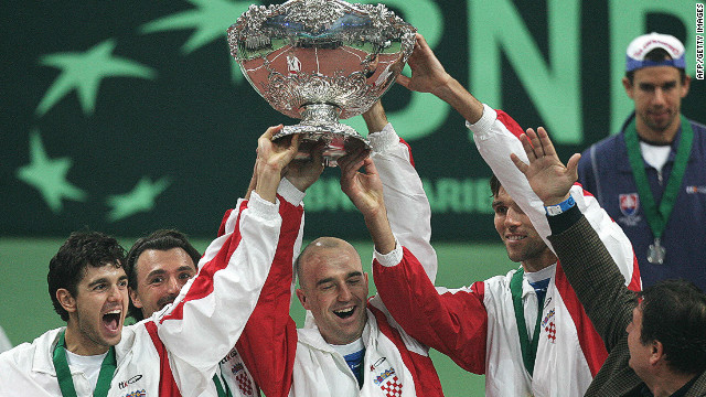 Croatia's team of (L-R) Mario Ancic, Goran Ivanisevic, Ljubicic, Ivo Karlovic hold the Davis Cup trophy aloft for the first and only time so far after defeating Slovakia 3-2 in Bratislava in 2005. 