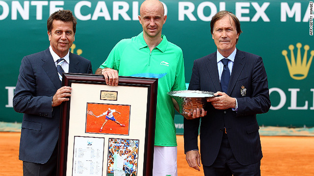 "ATP chief Brad Drewett (L) and director Zeljiko Franulovic present the Croatian with a special trophy and gift to mark his retirement from tennis. Drewett described Ljubicic as ""a true gentleman and ever popular amongst his peers."""