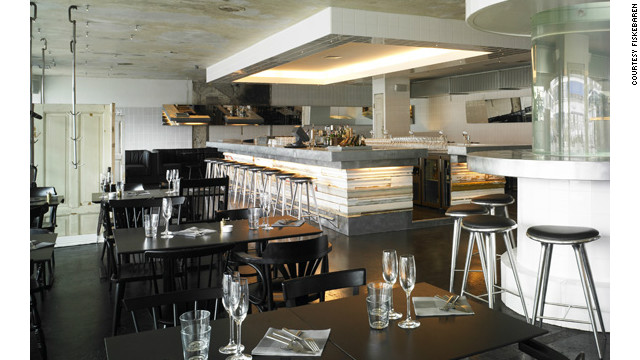 Stripped industrial chic characterizes the interior of Copenhagen's trendy Fiskebaren fish bar. The meat hooks hanging from the ceiling are a homage to Fiskebaren's location in the former meatpacking district.