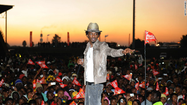 "K'naan performs ""Wavin' Flag"" on June 01, 2010, in Witbank, South Africa. The song was selected as the official anthem of the 2010 FIFA World Cup."